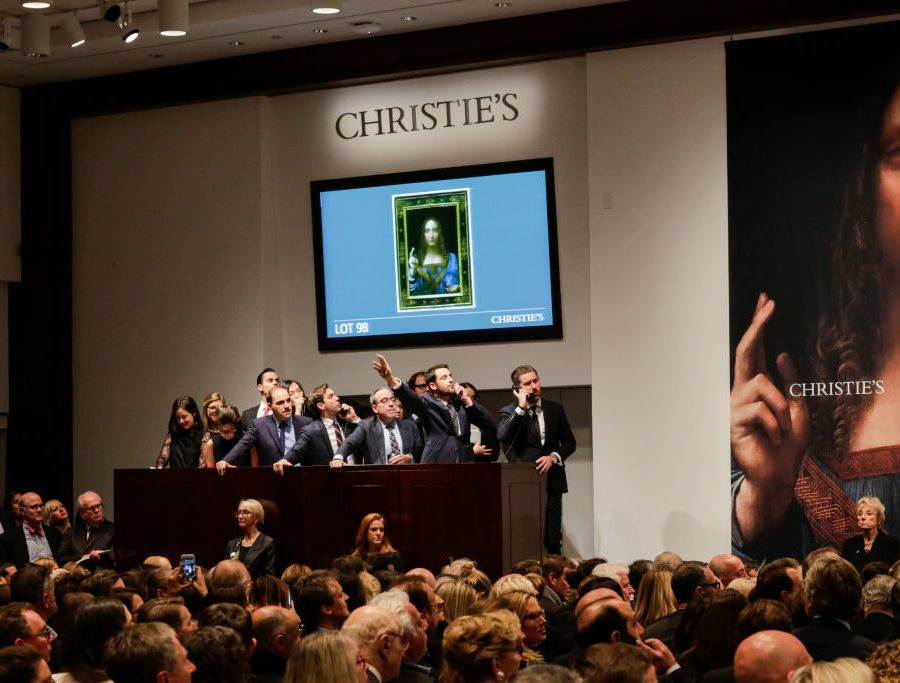 """NEW YORK, NY - NOVEMBER 15: Agents speak on their phones with their clients while bidding on at the auction of Leonardo da Vinci's """"Salvator Mundi"""" during the Post-War and Contemporary Art evening sale at Christie's on November 15, 2017 in New York City. The rediscovered masterpiece by the Renaissance master sells for an historic $450,312,500, obliterating the prevous world record for the most expensive work of art at auction. (Photo by Eduardo Munoz Alvarez/Getty Images)"""